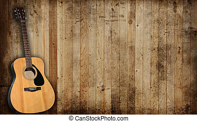 Guitar - Acoustic guitar against an old barn background.
