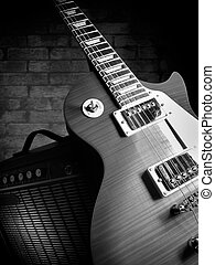 electric guitar and amplifier with brick wall in the background, closeup, for music and entertainment themes