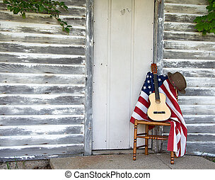 guitar and hat on American flag