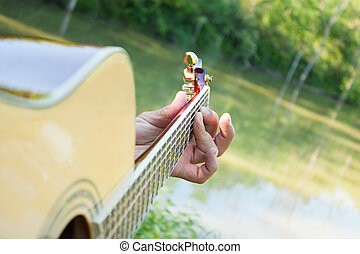 Guitar at the Pond
