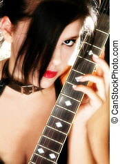 Guitar Babe - Beautiful teen girl with electric guitar over...