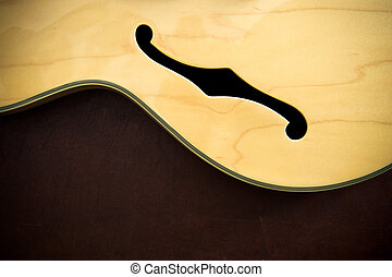 Guitar body detail with sound f-hole