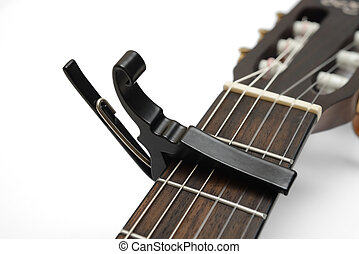 Electric Classic guitar neck with a capo
