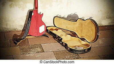 guitar case with coins and bills