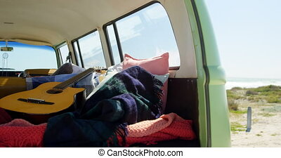 Guitar, cloths and blanket in van 4k - Guitar, cloths and ...