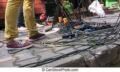 Guitar effects on stage at live concert