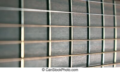 Guitar fret and strings. Music performance. 4K macro dolly video