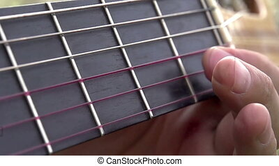 Guitar Fretboard - Fingers guitarist slowly pull the strings...