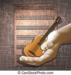 Guitar in hand on the texture background