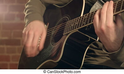 Guitar in male hands