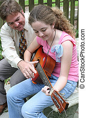 Guitar Lesson 1 - A father teaching his daughter to play...