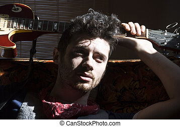 Guitar Man Max - Stock photo of a young man with curly hair...