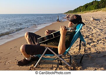 Guitar Man on the Shore