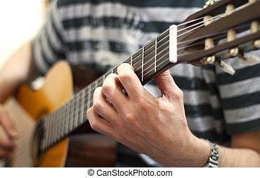 Guitar - Man playing an acoustic guitar