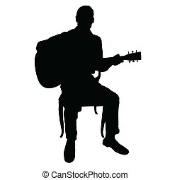 Guitar Man - Silhouette of a man playing an acoustic guitar