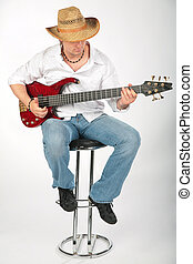 guitar man with hat on chair
