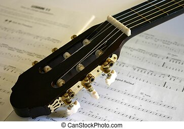 Guitar Music - Acoustic guitar head with sheet of music