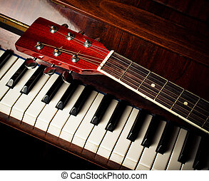 guitar neck on old piano keys - acoustic guitar neck on...