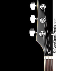 Guitar neck - top of the guitar neck over black background,...