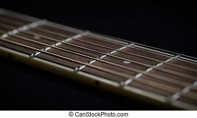 Guitar neck with strings closeup. guitar fretboard