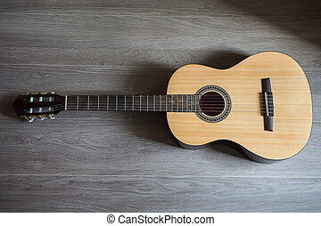 Guitar on wooden background, fretboard