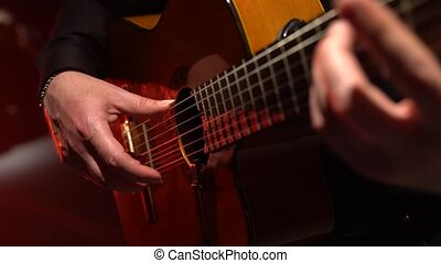 Guitar play a melody man. Close up - Guitar playing a melody...