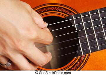 Guitar player - Close up on a man playing guitar