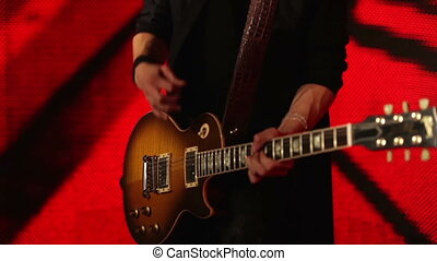 Guitar player on a red background