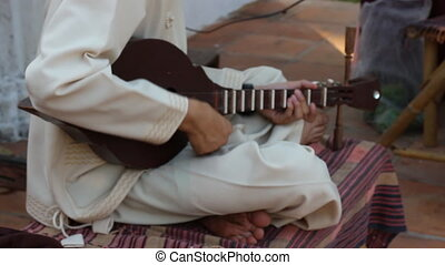 Guitar Player Playing Local Song Outdoor