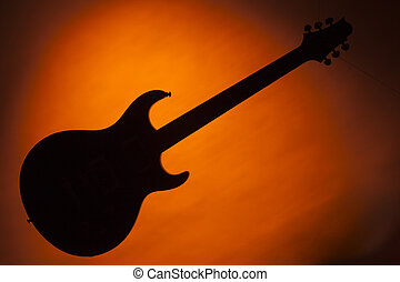 Guitar Silhouette Isolated on Gold