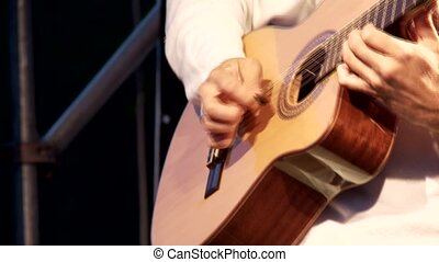 Guitar - video footage of a man playing acoustic guitar