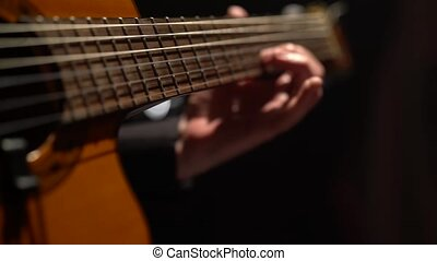 Guitar the male fingers fingering . Close up - Guitar the...