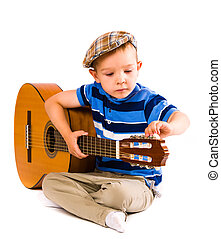 Child, 5 years old, tunes the guitar, white background