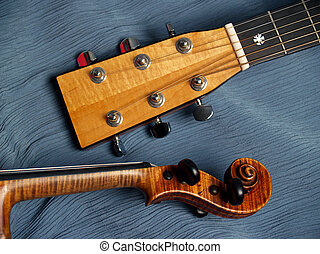 Guitar, Violin Heads - pair of musical instrument necks and...
