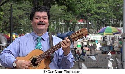 Guitarist at Park Plaza on Sunday