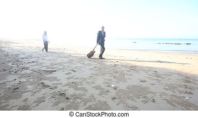 guitarist goes away pulls guitar along sand and girl follows him