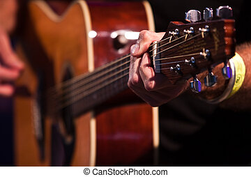 Guitarist hand with an classical guitar - sharp foreground hand