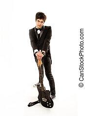 guitarist in a tuxedo