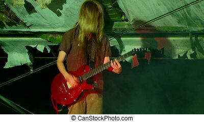 Guitarist in smoke