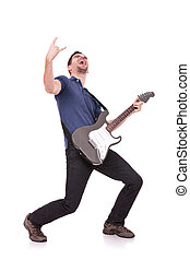 guitarist making a rock and roll gesture