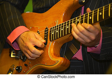 man is playing the guitar