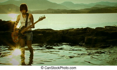 Guitarist on the beach. Old movie