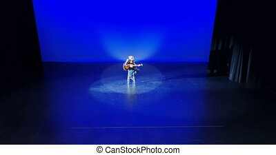 Male guitarist performing on the stage 4k