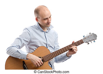 Guitarist playing acoustic guitar isolated on white