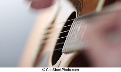 Guitarist playing acoustic guitar - Close up of man playing...