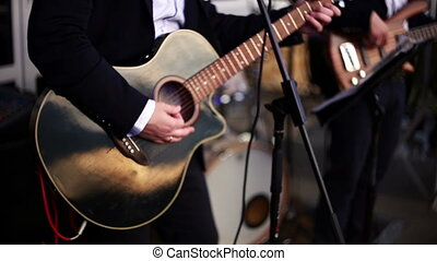 Guitarist playing an acoustic guitar. - musical band...