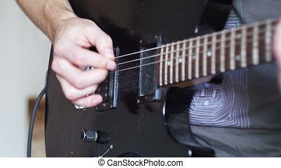 Guitarist Playing An Electric Guitar At Home Studio
