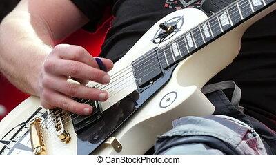 Guitarist playing  guitar at rock festival