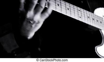 Guitarist Playing Guitar in the Music Studio