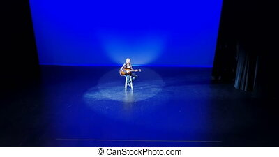 Guitarist playing guitar on stage 4k - Male guitarist...